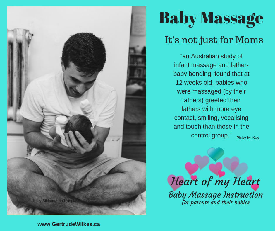 Father sitting cross legged on the floor looks lovingly at young baby he gently in front of him cradling the tiny child's head in his hand. Text cites the benefits of infant massage.